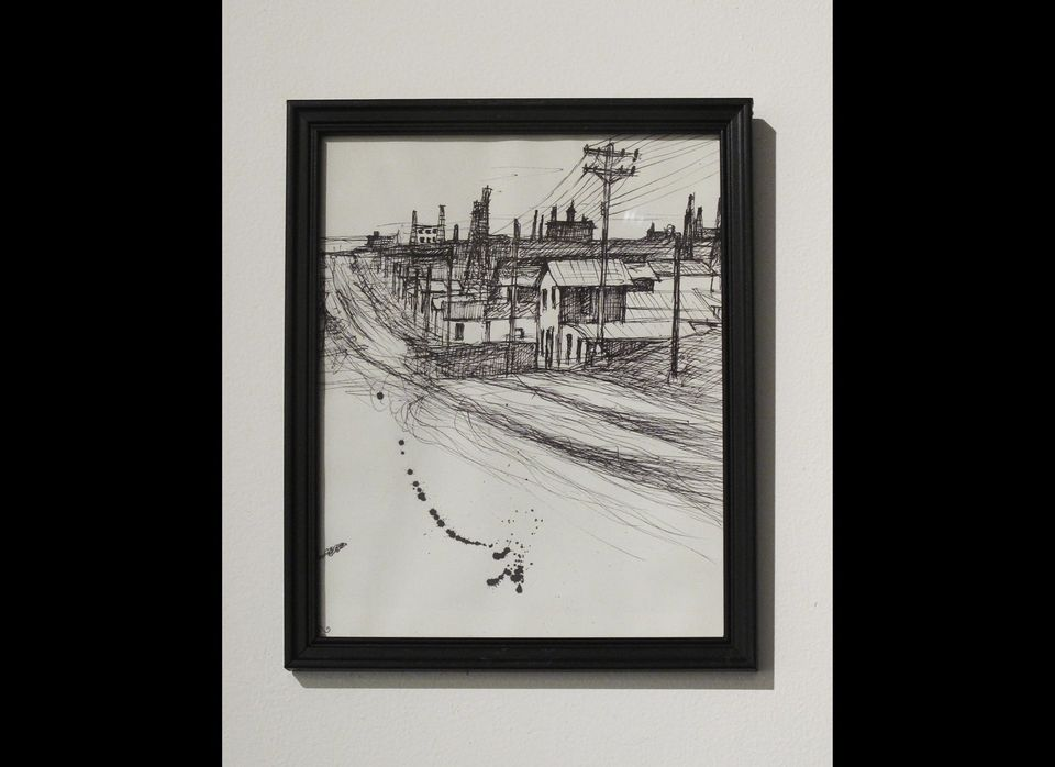 One wall featured a series of drawings, pen and pencil on paper. Each expert cityscape demonstrates a lonely town in a leafle