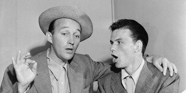 Bing Crosby, left, and Frank Sinatra break out in song in Bing's dressing room between radio programs in Hollywood, Ca., Sept