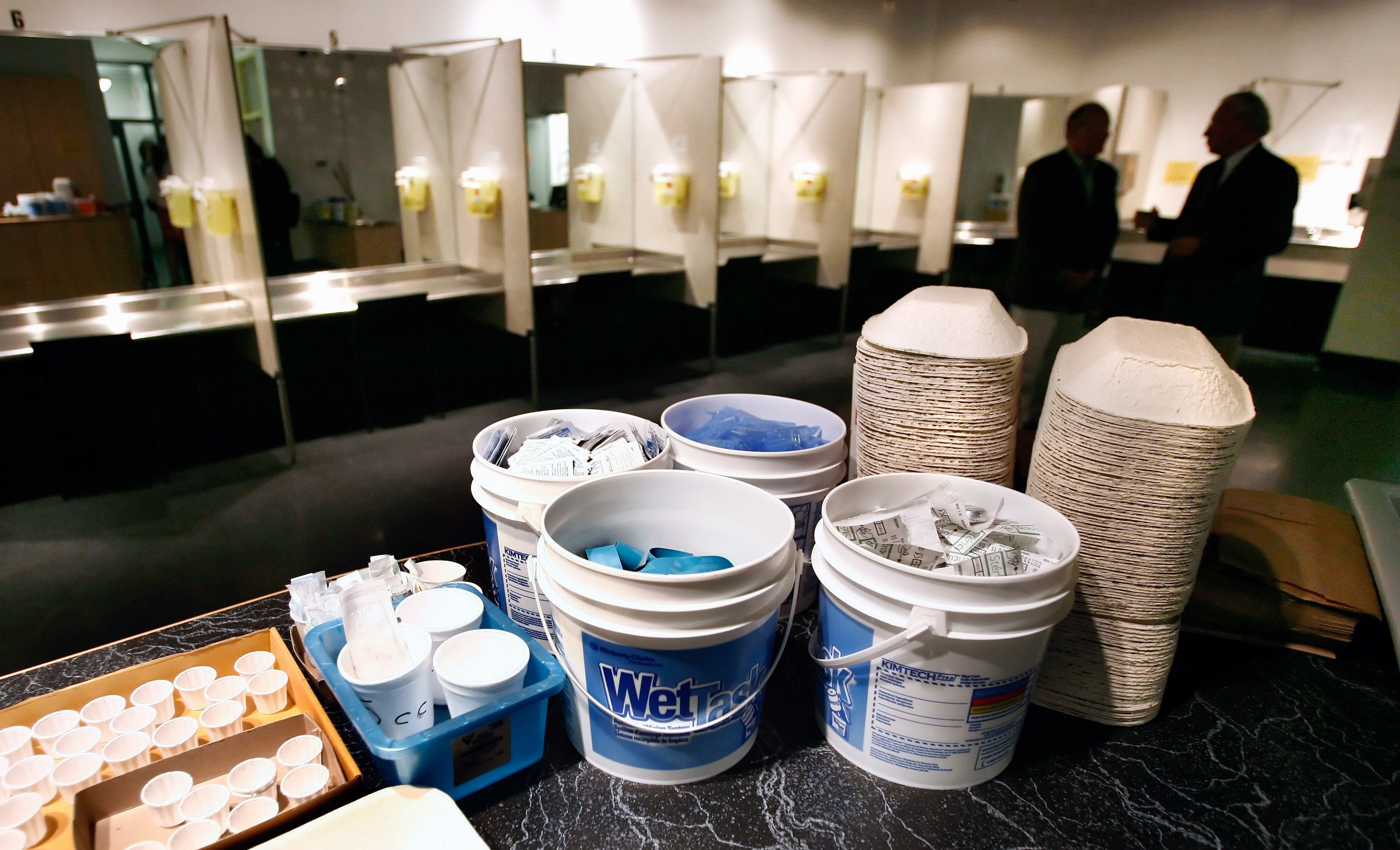 "Supplies including syringes, bandaids and antiseptic pads waits to be used by a drug addict inside a safe injection site on Vancouver, British Columbia's eastside August 23, 2006. Known as Insite the facility opened three years ago and operates legally after the federal and provincial governments gave their blessing. Inside, addicts can shoot up their own heroin or cocaine under the supervision of a nurse. The Health Canada exemption runs out Sept. 12 and Prime Minister Stephen Harper has said he's ""not committed"" to renewing it.        REUTERS/Andy Clark (CANADA)"