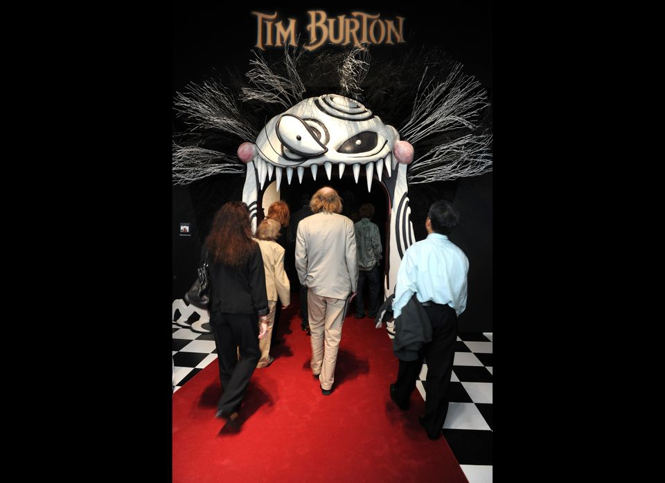 A visitor attends the preview of the Tim Burton's exhibition at the LACMA in Los Angeles, California on May 25, 2011.