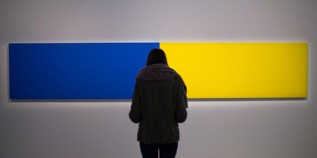 A visitor looks at the artwork 'Two Panels - Blue-Yellow' (1970) by US artist Ellsworth Kelly as part of the exhibition 'J'ai