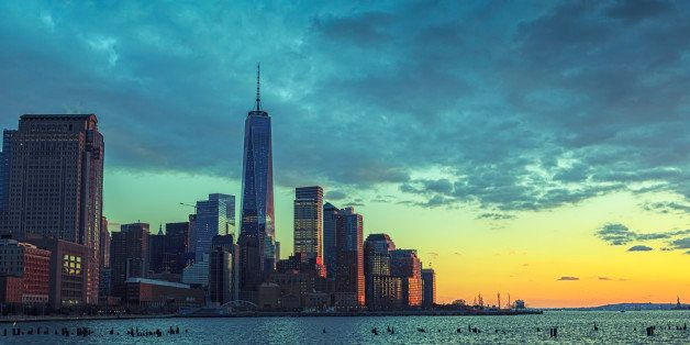 Dramatic sky over Manhattan with Freedom tower during sunset
