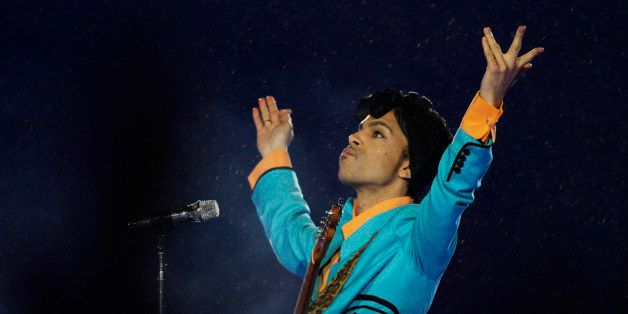 FILE- In this Feb. 4, 2007, file photo, Prince performs during the halftime show at Super Bowl XLI at Dolphin Stadium in Miam
