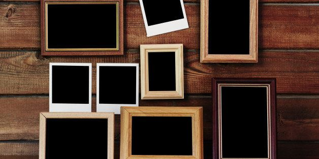 old photo frames on the wooden...