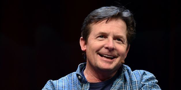 Michael J. Fox speaks to a crowd during a panel discussion about 'Back to the Future' during the Silicon Valley Comic Con in