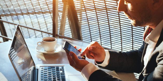 business man using internet on  smart phone and laptop