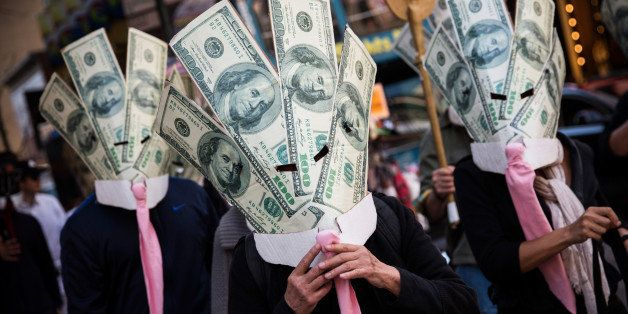 NEW YORK, NY - SEPTEMBER 17:  Occupy Wall Street protesters wearing masks made out of enlarged dollar bills act in a short sk