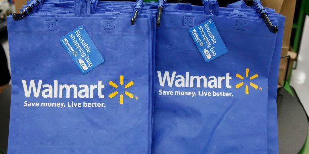 FILE - In this Thursday, Sept. 19, 2013, file photo, reusable shopping bags are offered for sale at a Wal-Mart Neighborhood M