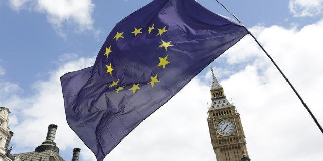 A European Union flag is held in front of the Big Ben clock tower in Parliament Square during a 'March for Europe' demonstrat