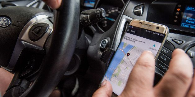 A driver uses a Samsung Electronics Co. Galaxy edge smartphone displaying the Uber Technologies Inc. car service taxi applica