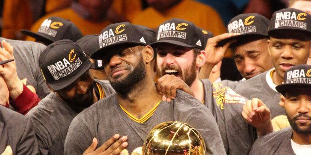 OAKLAND, CA - JUNE 19:  LeBron James #23 of the Cleveland Cavaliers holds up the Larry O'Brien Trophy after the 2016 NBA Fina