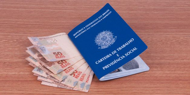 Brazilian work document and social security document (carteira de trabalho) and brazilian currency (Real)