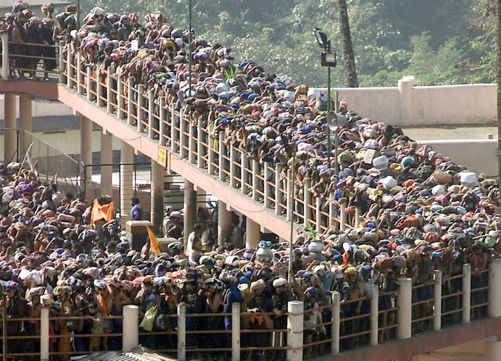 Hindu pilgrims line up at the Sabarimala Temple to offer prayers to the Hindu deity Ayappa in 2003.