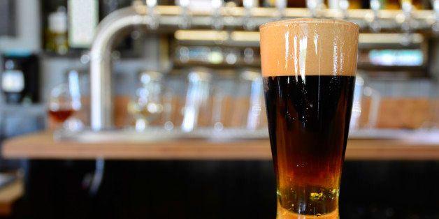 a single glass of black velvet at the bar.
