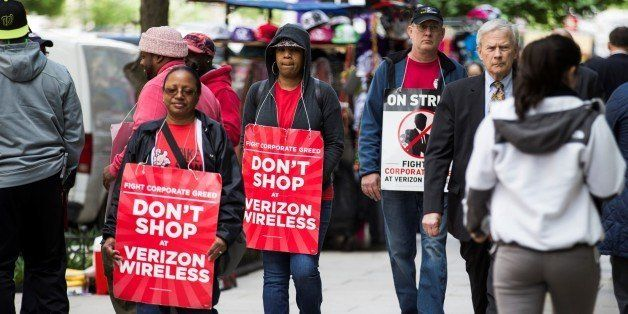 WASHINGTON, USA - MAY 18: Verizon workers on strike march outside of a Verizon Wireless store in downtown Washington, USA on