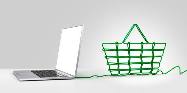 Laptop computer with green ethernet cable forming a shopping basket, coming out of the back on a plain background