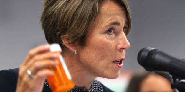 BOSTON - SEPTEMBER 1: Attorney General Maura Healey holds a CVS prescription bottle as she announced in a first-in-the-nation