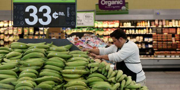 MIAMI, FL - FEBRUARY 19:  Walmart employee Dayngel Fernandez works in the produce department stocking shelves at a Walmart st
