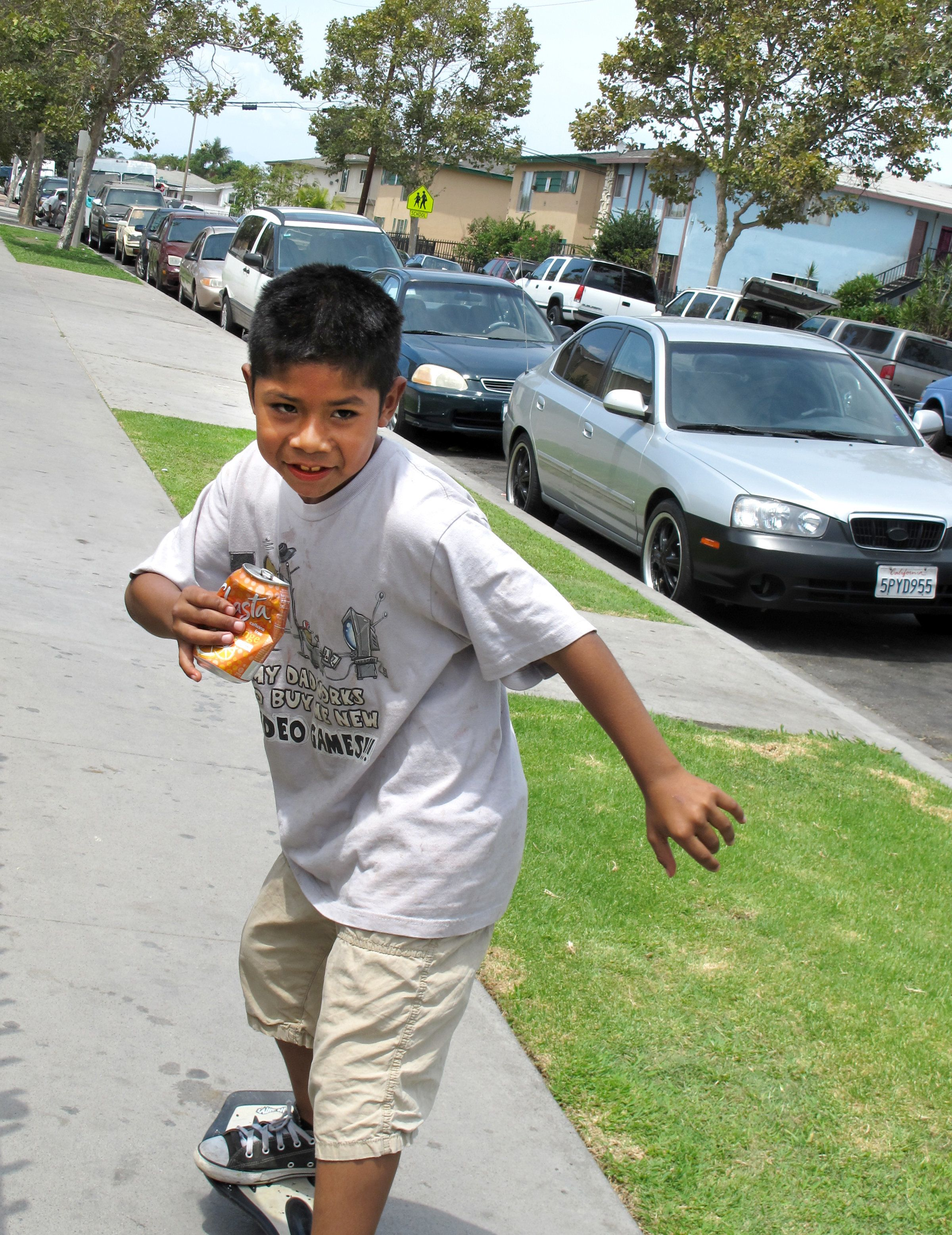 In the summer of 2014, Cesar Gaspar, 8, skateboards through his Townsend Street neighborhood in Santa Ana during a community