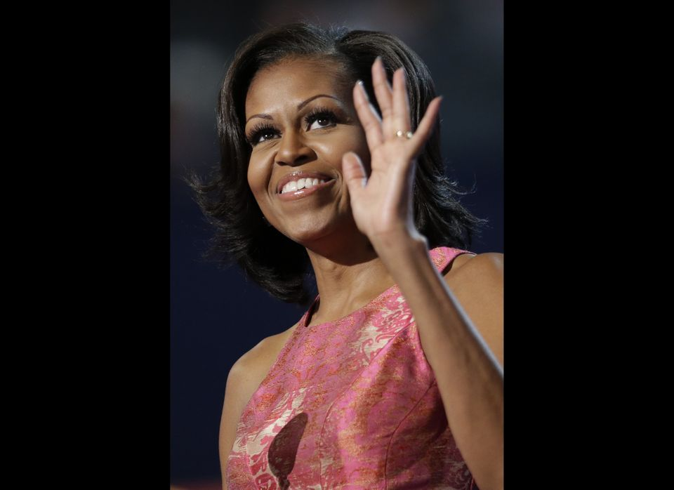 First lady Michelle Obama waves to delegates at the Democratic National Convention in Charlotte, N.C., on Tuesday, Sept. 4, 2