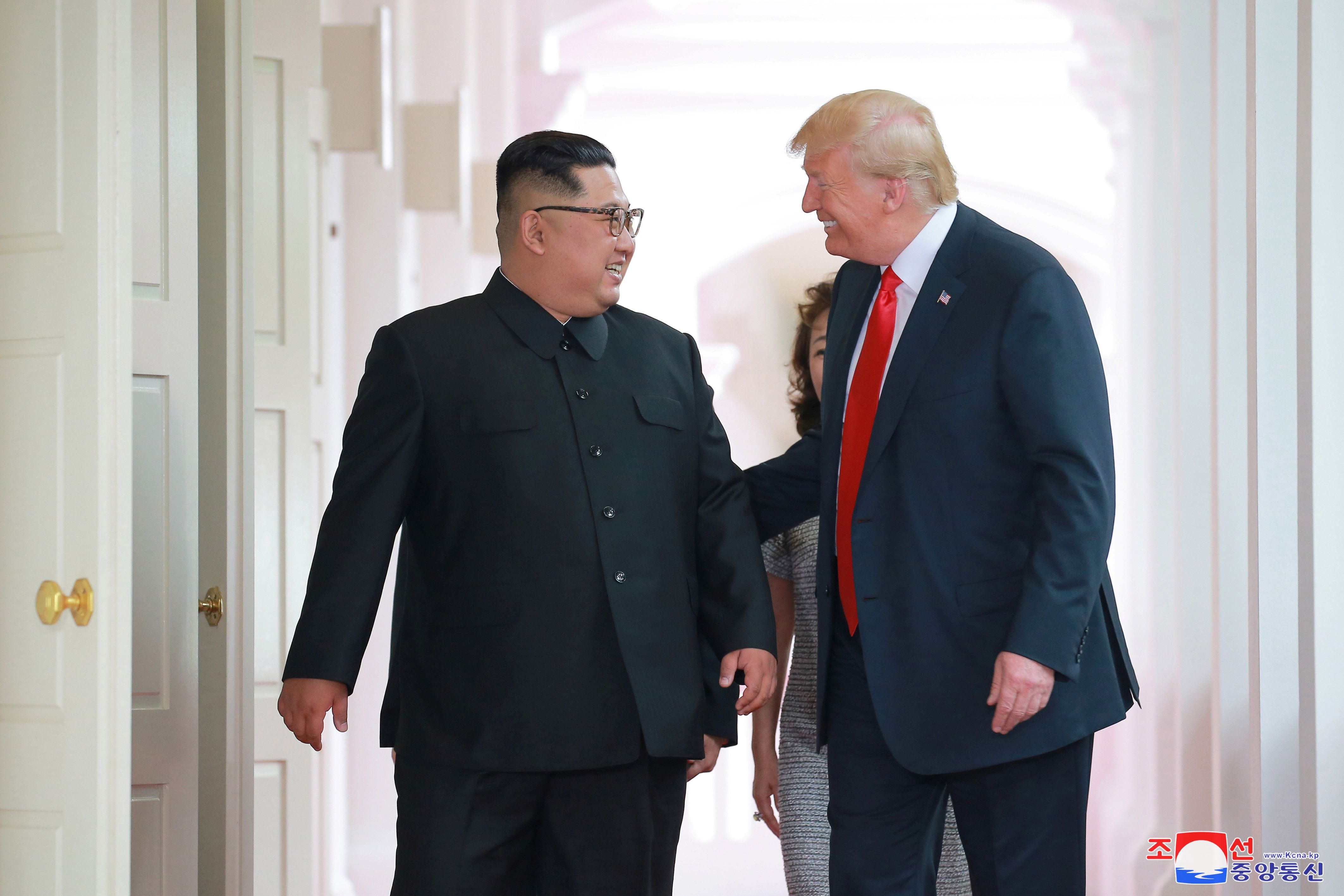 U.S. President Donald Trump walks with North Korean leader Kim Jong Un at the Capella Hotel on Sentosa island in Singapore in this picture released on June 12, 2018 by North Korea's Korean Central News Agency. KCNA via REUTERS ATTENTION EDITORS - THIS PICTURE WAS PROVIDED BY A THIRD PARTY. REUTERS IS UNABLE TO INDEPENDENTLY VERIFY THE AUTHENTICITY, CONTENT, LOCATION OR DATE OF THIS IMAGE. NO THIRD PARTY SALES. NOT FOR USE BY REUTERS THIRD PARTY DISTRIBUTORS. SOUTH KOREA OUT. NO COMMERCIAL OR EDITORIAL SALES IN SOUTH KOREA.