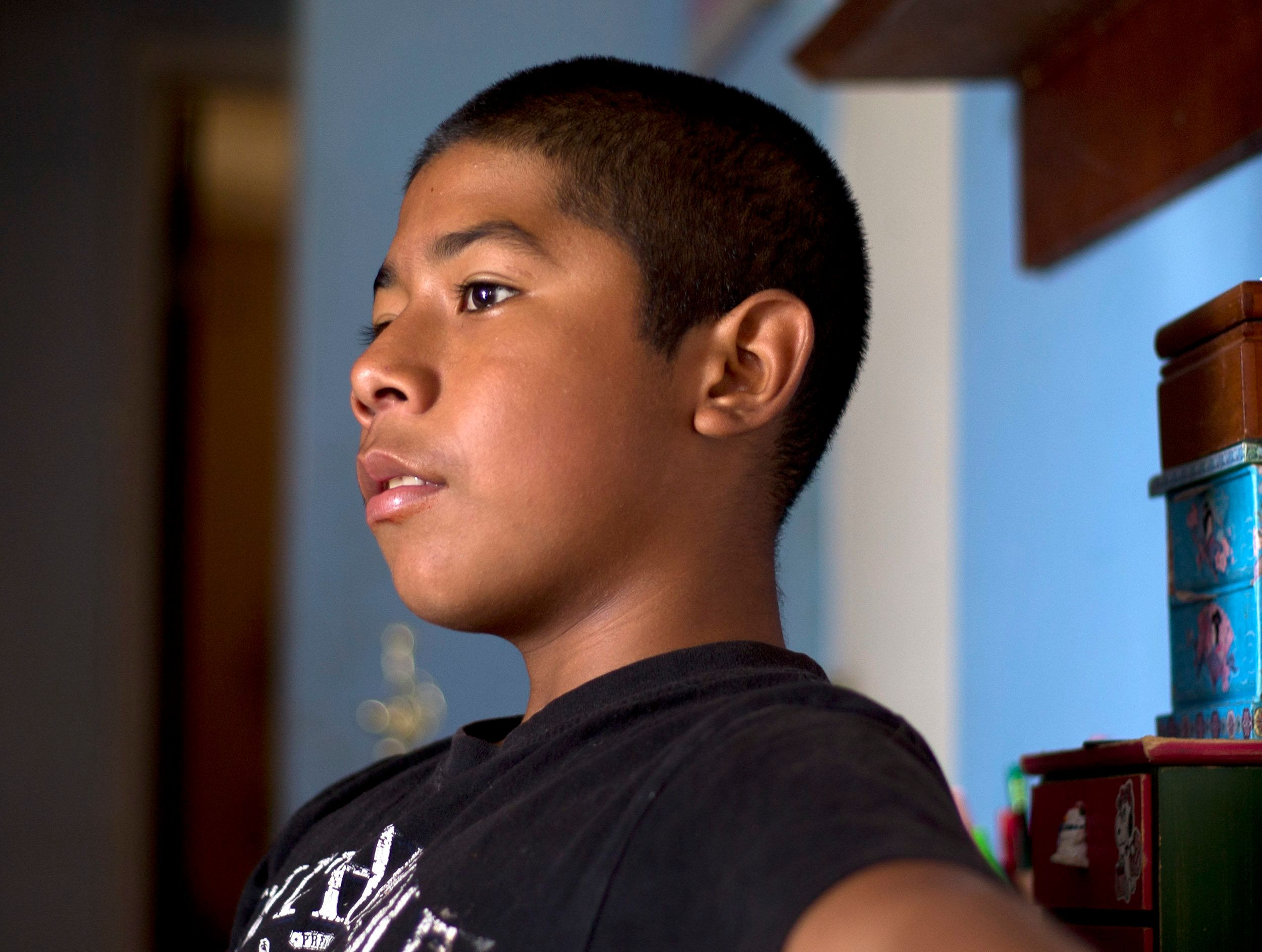 Cesar, 13, in his Santa Ana apartment shortly before his August 2018 juvenile court hearing.