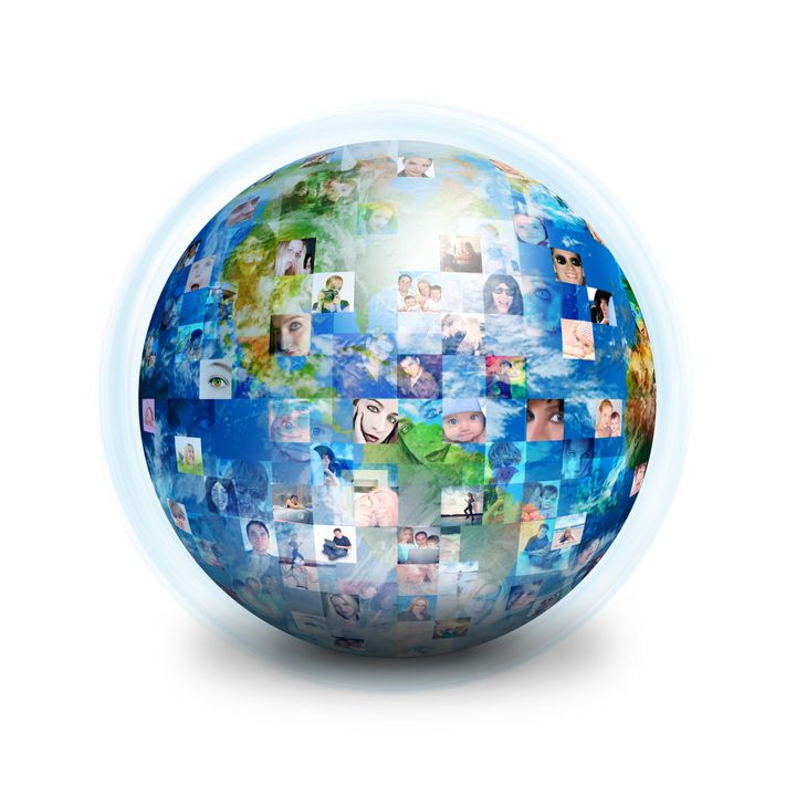 A globe is isolated on a white background with many different people's faces. Can represent a technology social network of fr