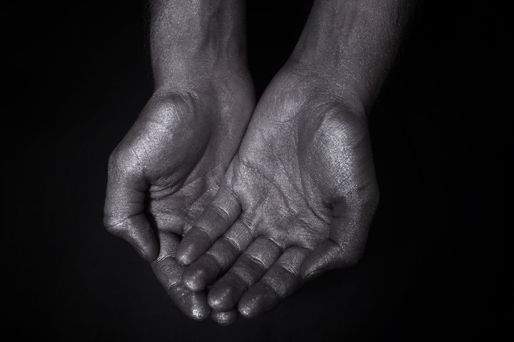 two hands folded a handful on a ...