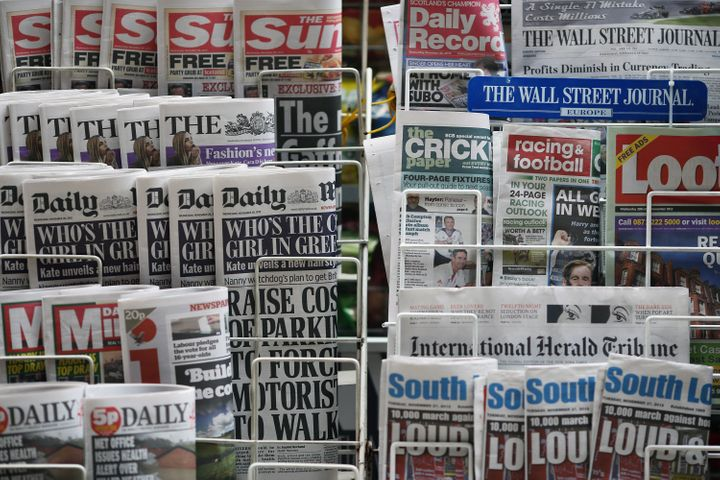 LONDON, ENGLAND - NOVEMBER 28:  Newspapers are displayed on a stand outside a newsagent on November 28, 2012 in London, Engla