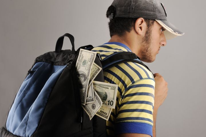 young arabic man with backpack...
