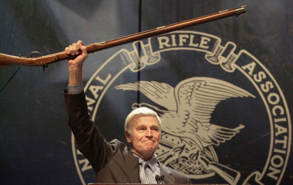 NRA president Charlton Heston holds up a musket as he tells the 5000 plus members attending the 129th Annual Meeting & Exhibi