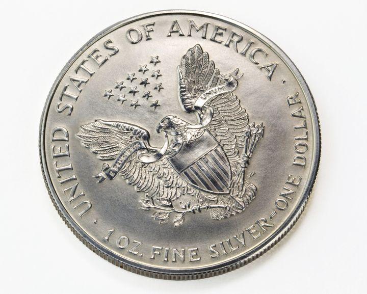 silver one dollar coin macro