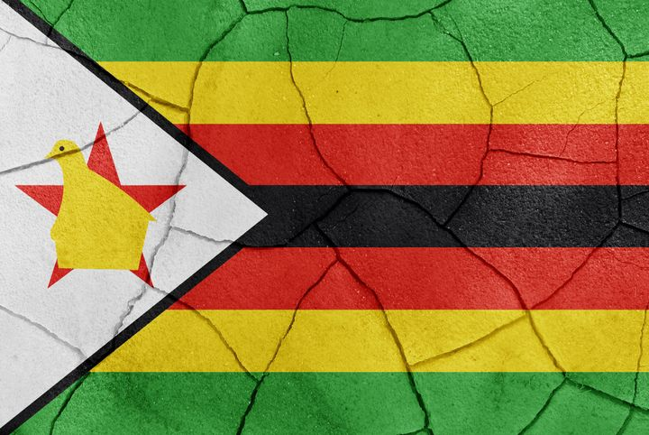 the zimbabwe flag painted on a...