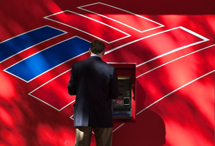 CHARLOTTE, NC - OCTOBER 24: A man uses a Bank of America ATM on Tryon Street on October 24, 2012 in Charlotte, North Carolina