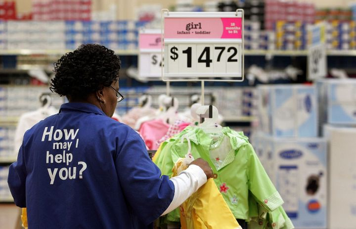 EVERGREEN PARK, IL - JANUARY 26: Wal-Mart sales associate Cherry Williams from Chicago arranges girl infant/toddler clothing