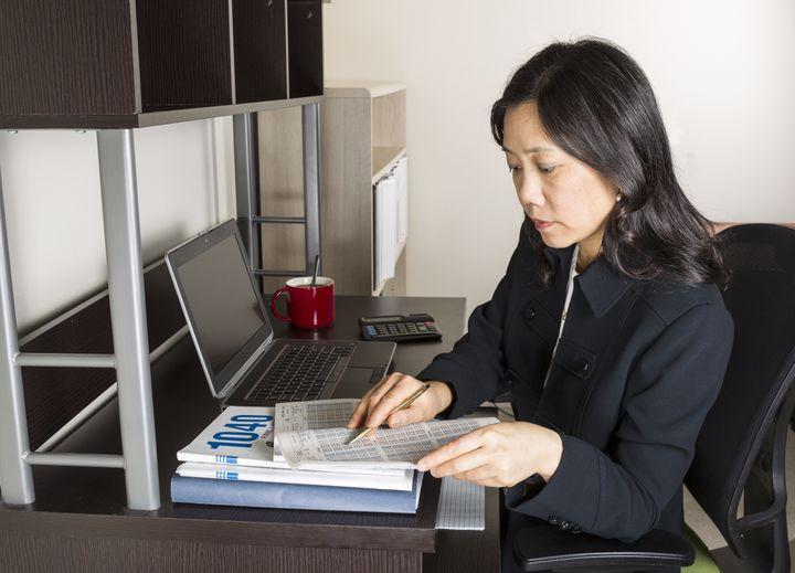 professional mature asian woman ...
