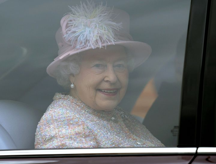Britain's Queen Elizabeth II smiles from inside her car as she leaves The Deanery at St Georges Chapel in Windsor Castle afte