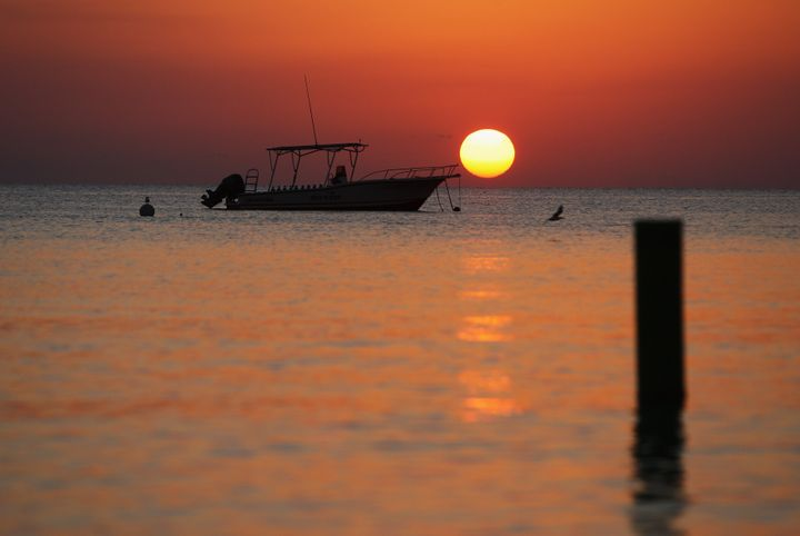 GEORGE TOWN, CAYMAN ISLANDS - APRIL 24:  Sunset off Seven Mile Beach on 24 April, 2008 in Grand Cayman, Cayman Islands.  (Pho