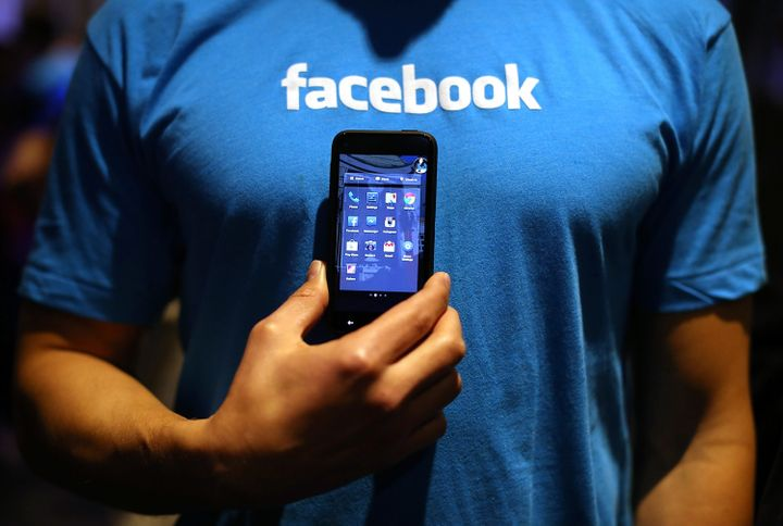 MENLO PARK, CA - APRIL 04:  A Facebook employee holds a phone that is running the new 'Home' program during an event at Faceb