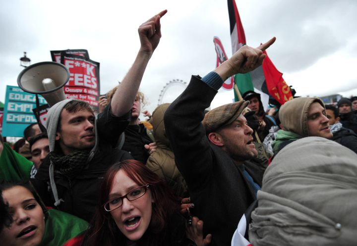 Protestors shout at police during a student rally in central London on November 21, 2012 against sharp rises in university tu