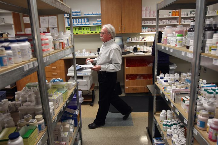 AURORA, CO - MARCH 27:  Pharmacy director Hank Wedemeyer prepares to fill a prescription at a community health center on Marc