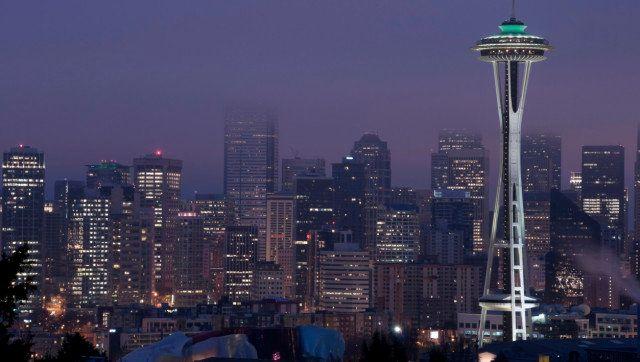 Foggy Seattle skyline at twilight just before sunrise.
