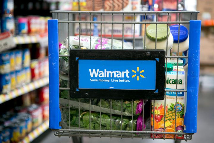 Grocery items sit inside a cart at a Wal-Mart store in Alexandria, Virginia, U.S., on Wednesday, Nov. 14, 2012. Wal-Mart Stor