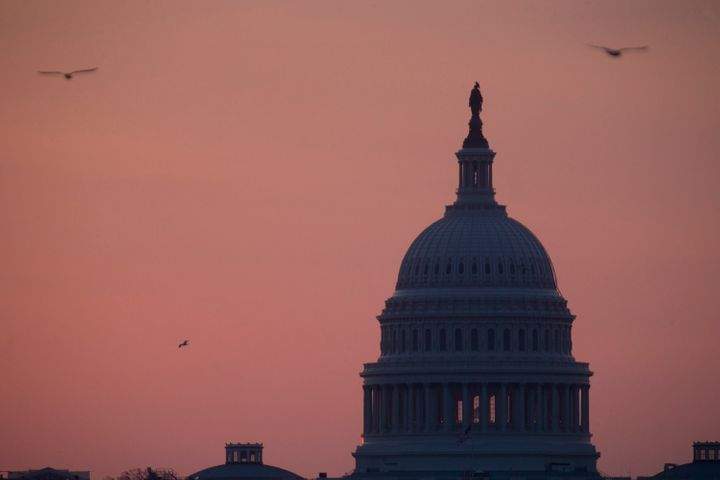 Birds fly around the U.S. Capitol in Washington, D.C., U.S., on Tuesday, April 9, 2013. Less than a week after job-creation f