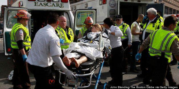 BOSTON - APRIL 15: A patient is transported to an ambulance from a medical tent at Copley Square in Boston after two explosio