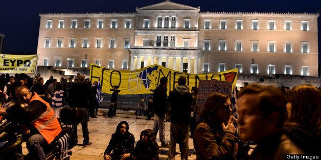 Protesters demonstrate outside the parliament against the austerity measures of Greek and Cypriot governments on March 31, 20