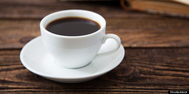 cup of coffee on a wooden table
