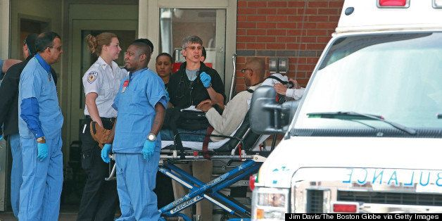BOSTON - APRIL 15: A man is wheeled into the Emergency Room of Boston Medical Center following the explosions near the finish