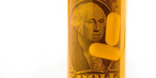 One dollar bills rolled inside a pill bottle with pills.