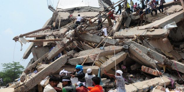 Bangladeshi volunteers and rescue workers are pictured at the scene after an eight-storey building collapsed in Savar, on the